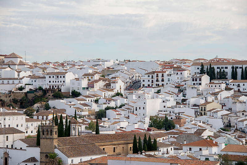 Wide angle shot of white houses in Ronda, Spain. by Mike Marlowe for Stocksy United