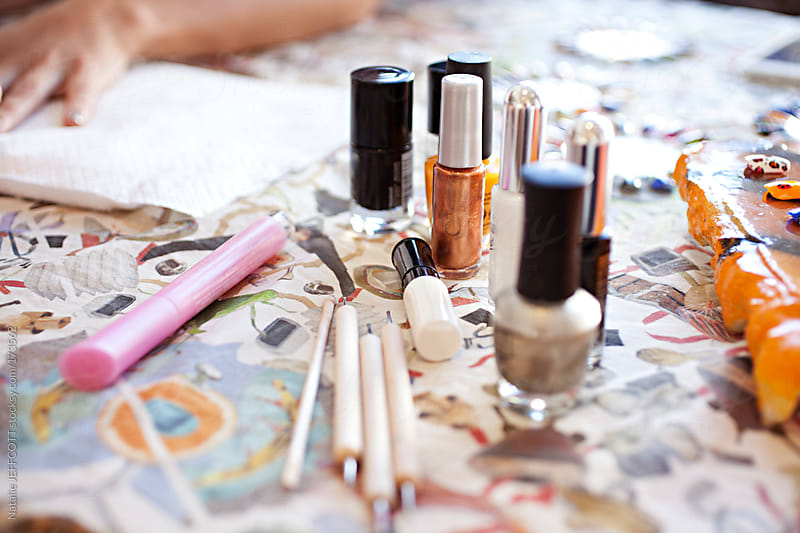 table top view of manicure / nail art - nail polish, brushes and paints by Natalie JEFFCOTT for Stocksy United