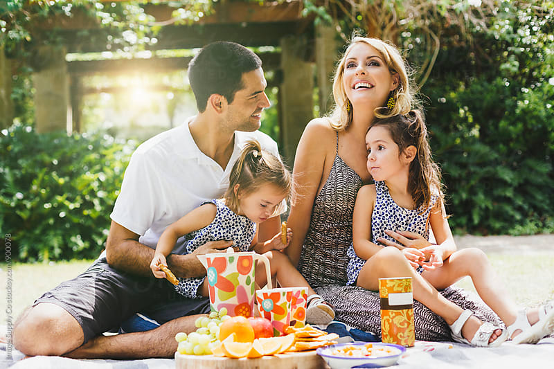 Happy couple enjoying family picnic on summer day. by Image Supply Co for Stocksy United