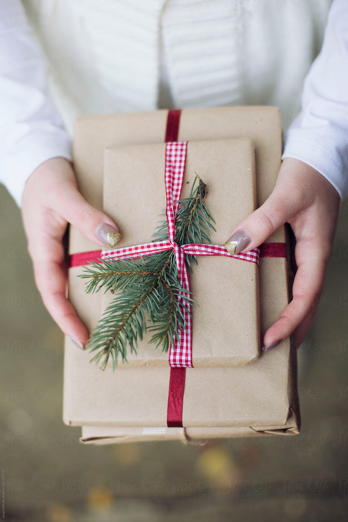 Woman Holding Christmas Gifts | Stocksy United