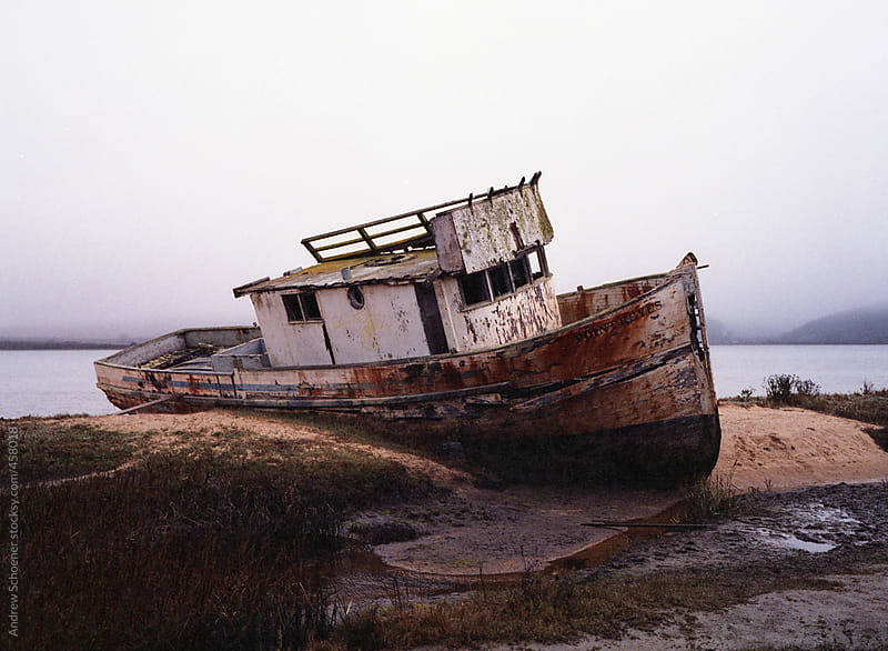 shore boat by Andrew Schoener for Stocksy United