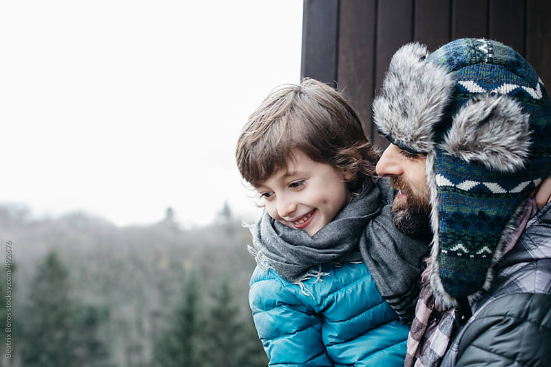 Man and his son looking at the nature and both smiling by Beatrix Boros for Stocksy United