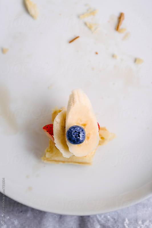 waffle breakfast, the last bite by Gillian Vann for Stocksy United