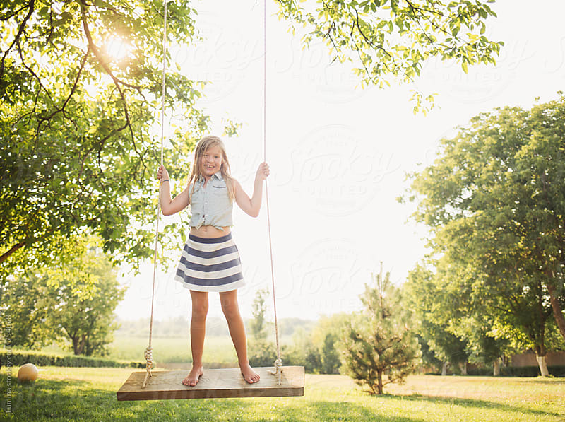 Blonde Girl Standing on a Swing  by Lumina for Stocksy United