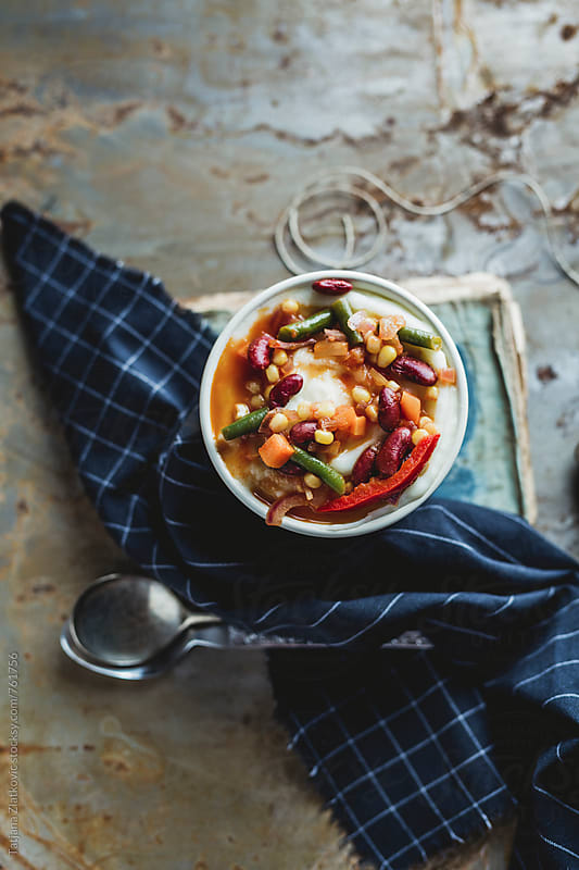 Mashed potatoes with mexican stir fried vegetables by Tatjana Zlatkovic for Stocksy United