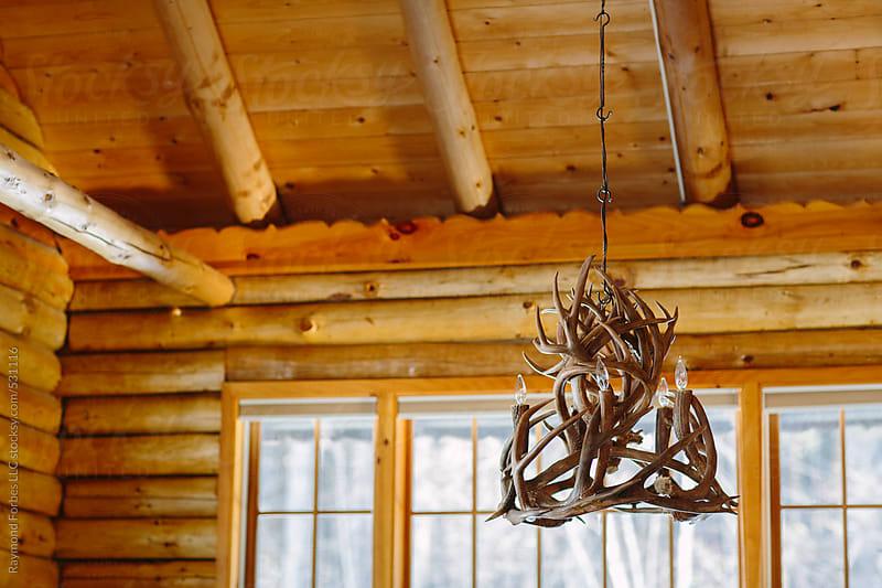 Deer Antler Chandelier in Log Cabin by Raymond Forbes LLC for Stocksy United