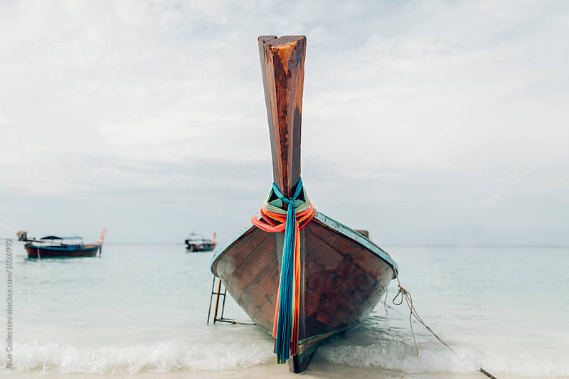 Longtailboat on a beach in the andaman sea by Jordi Rulló for Stocksy United
