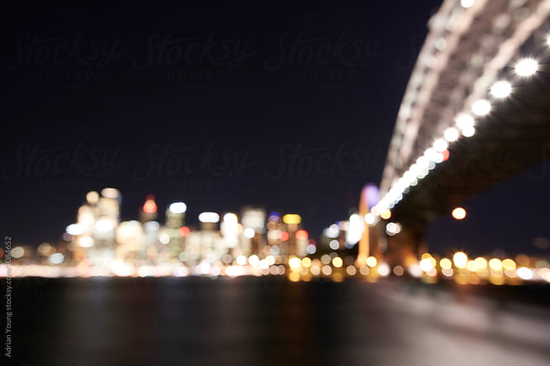 Out of focus view of the Sydney Harbour Bridge and Sydney city skyline. by Adrian Young for Stocksy United