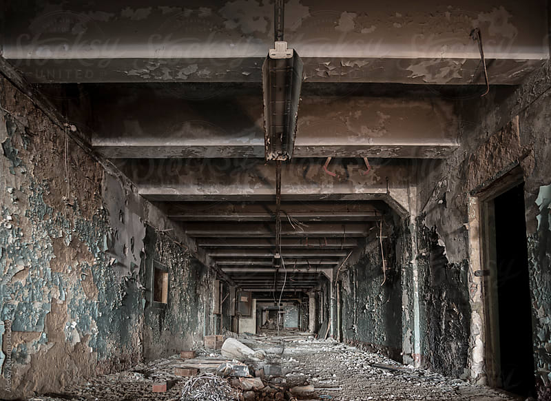 old abandoned burn corridor on the russian factory by Alexey Kuzma for Stocksy United