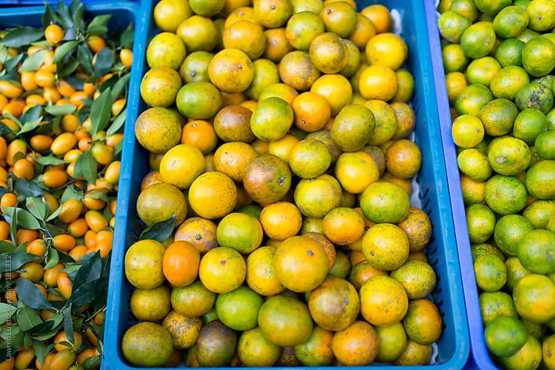 Heaps of oranges in basket by Lawren Lu for Stocksy United