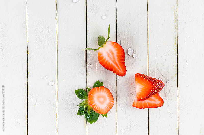 Fresh Sliced Organic Strawberries by suzanne clements for Stocksy United