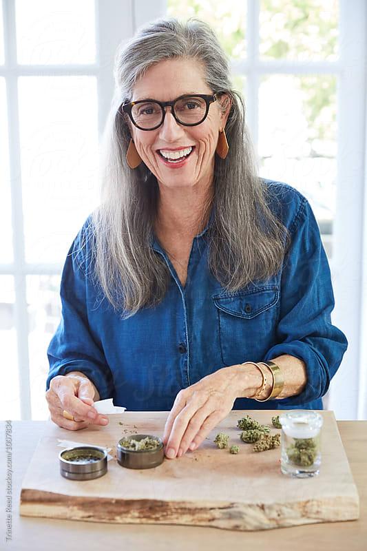 Senior woman using medical marijuana/cannabis by Trinette Reed for Stocksy United