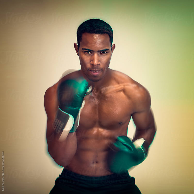 African American male boxer with fast hands by Neil Kremer for Stocksy United