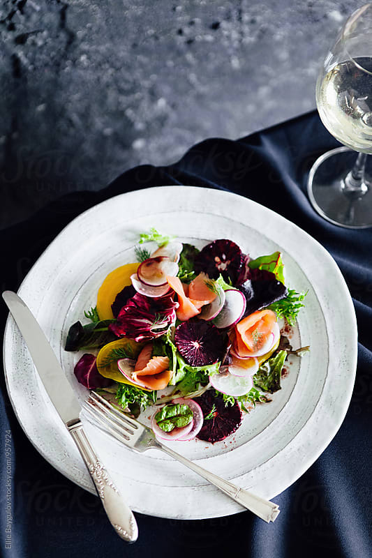 Smoked salmon salad by Ellie Baygulov for Stocksy United