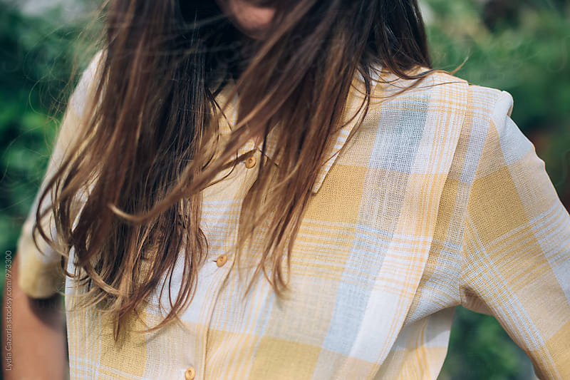young woman with a vintage yelow shirt by Lydia Cazorla for Stocksy United