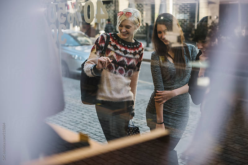 Three young women during shopping in the city by GIC for Stocksy United