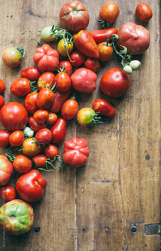 Variation of tomatoes on wooden surface by mee productions for Stocksy United