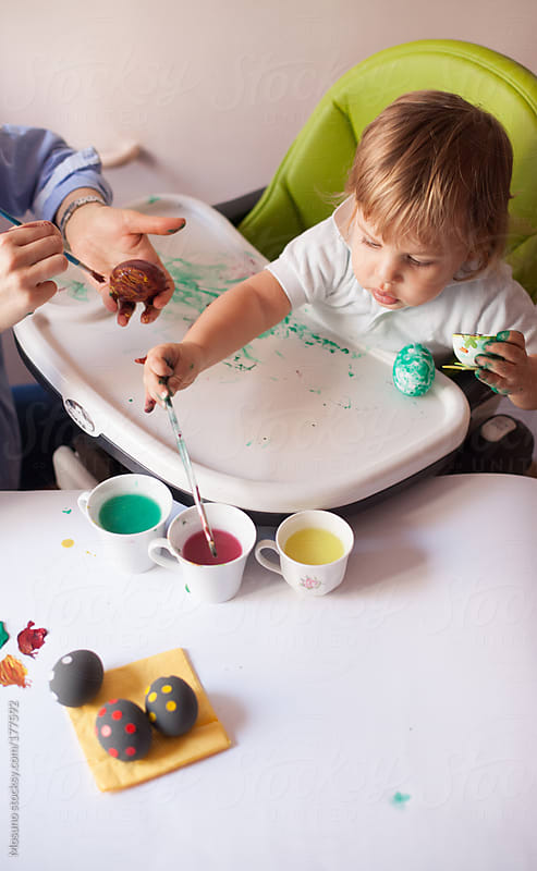 Baby Boy Colouring Easter Eggs by Mosuno for Stocksy United