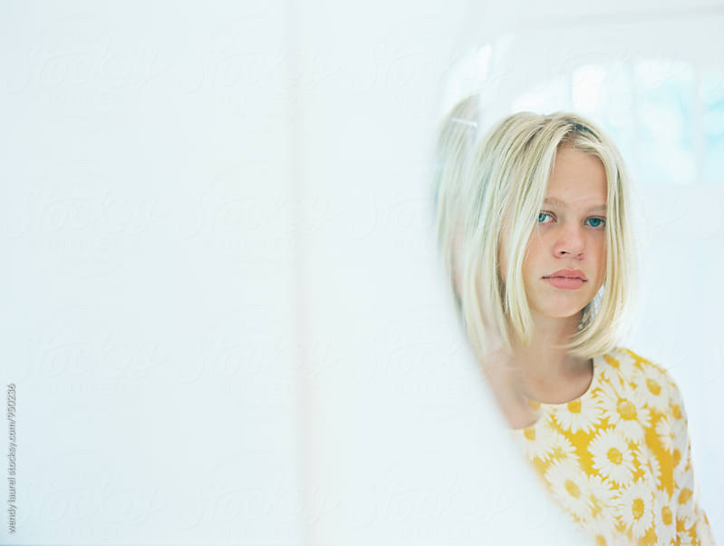 mirror reflection of blonde girl teen with white by wendy laurel for Stocksy United