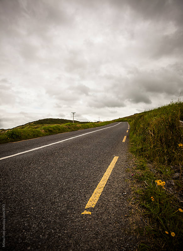 Empty road on a hillside by Michael Zwahlen for Stocksy United