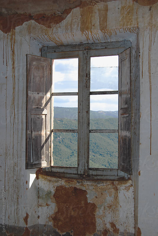 View from the window of an abandoned house by Luca Pierro for Stocksy United