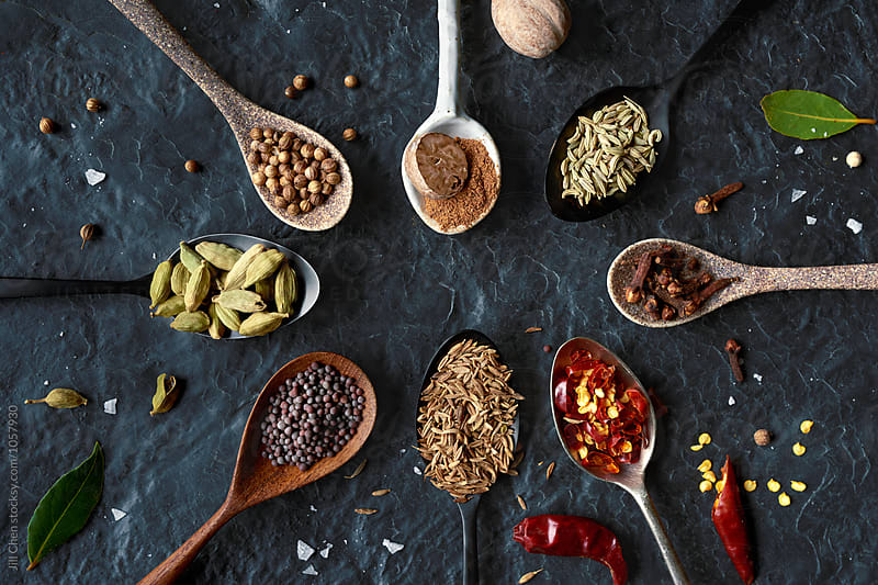 Dried exotic spices on different beautiful spoons by Jill Chen for Stocksy United