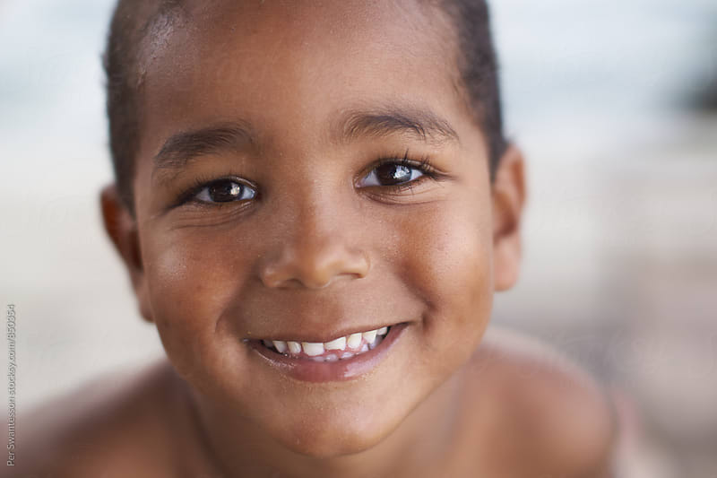 Boy smiling at camera by Per Swantesson for Stocksy United