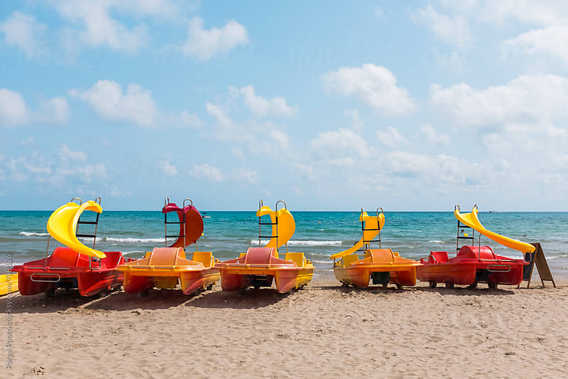 Colorful rental boats at beach by German Parga for Stocksy United