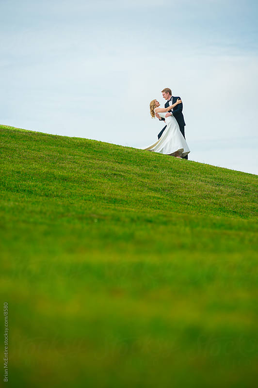 Newly Married Couple on Infinity Hill by Brian McEntire for Stocksy United