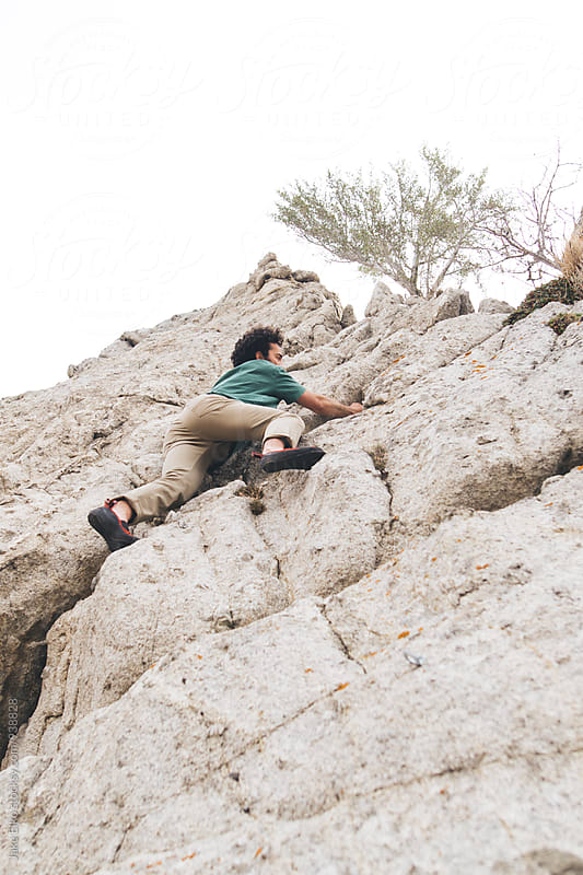 Man Rock Climbing in Utah by Jake Elko for Stocksy United