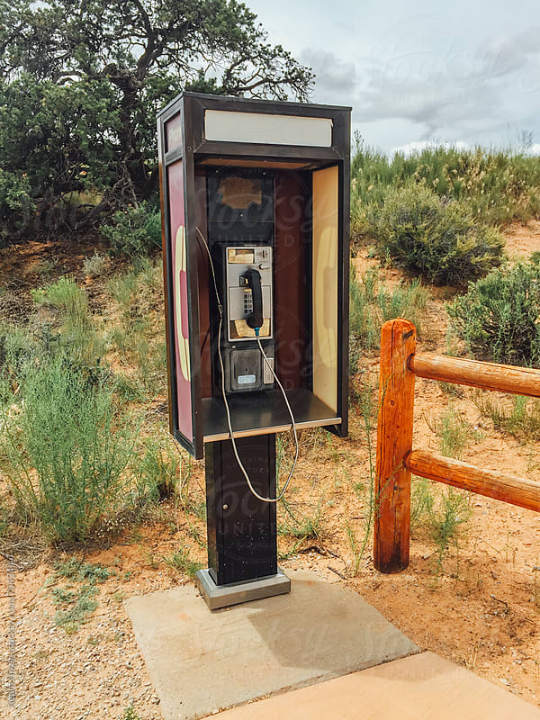 Old pay phone out in the desert by Adam Nixon for Stocksy United