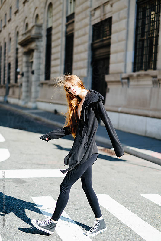 Attractive Woman Crossing the Road in NYC by Good Vibrations Images for Stocksy United
