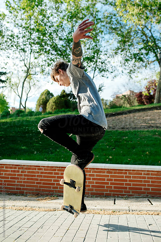 Young skater man jumping by Javier Marquez for Stocksy United