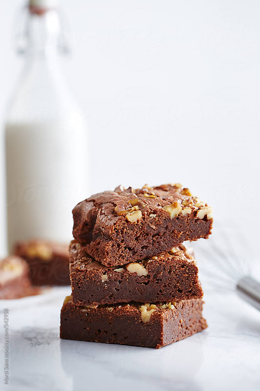 Stacked homemade brownies by Martí Sans for Stocksy United