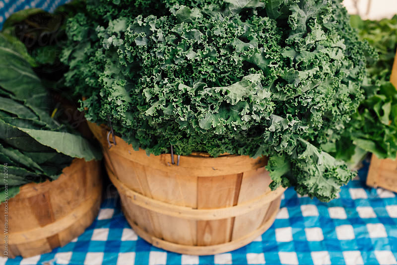 Baskets of kale at the farmers market by J Danielle Wehunt for Stocksy United