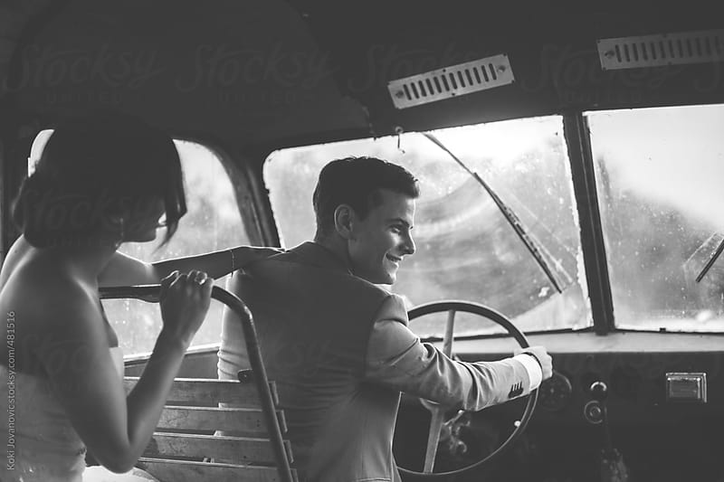 Beautiful couple going on road trip by bus by Koki Jovanovic for Stocksy United