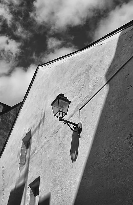 lantern on an old house by Marcel for Stocksy United