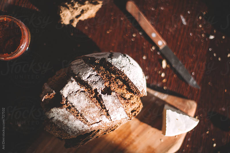 Homemade rustic bread by Ani Dimi for Stocksy United