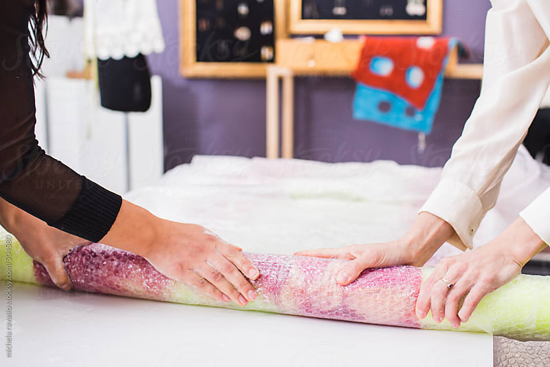 Young fashion stylist women creating a wool and silk scarf by michela ravasio for Stocksy United