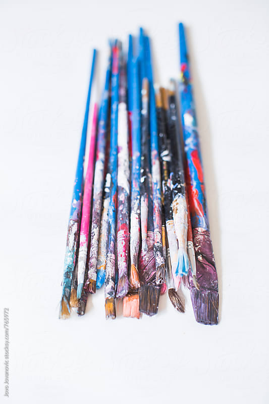 Used paint brushes on white background by Jovo Jovanovic for Stocksy United