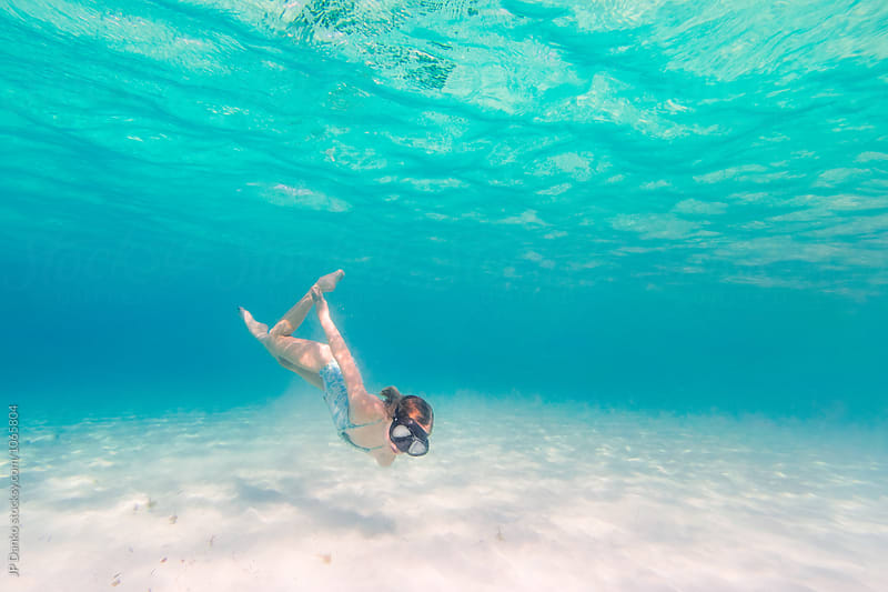 Little Girl Diving Underwater Swimming at All Inclusive Caribbean Resort White Sand Beach by JP Danko for Stocksy United