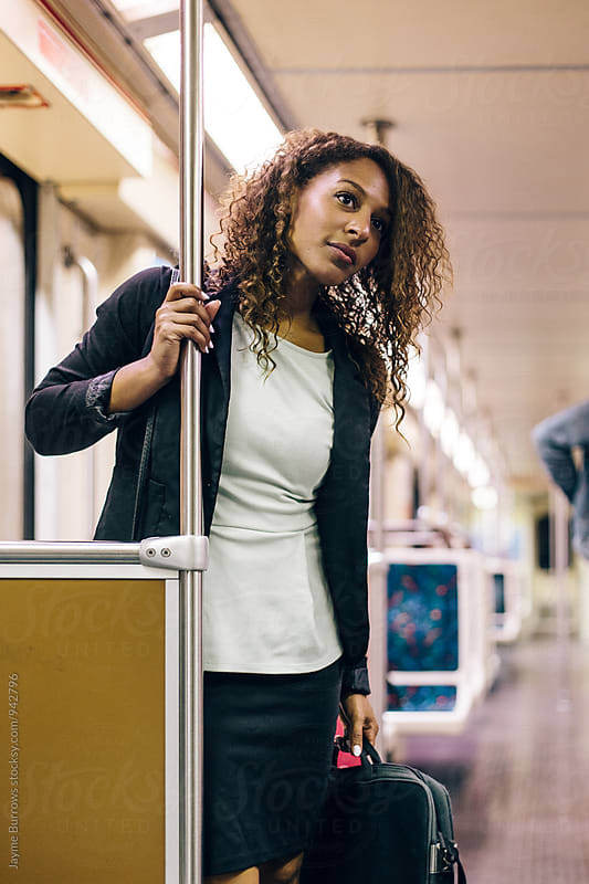 Young Professional Woman on the Subway by Jayme Burrows for Stocksy United