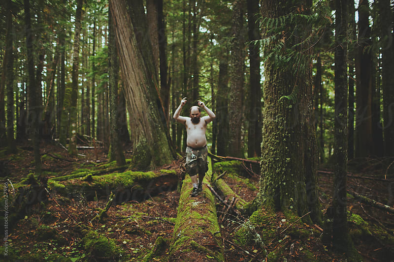 Shirtless Log Forest Man by Kevin Russ for Stocksy United