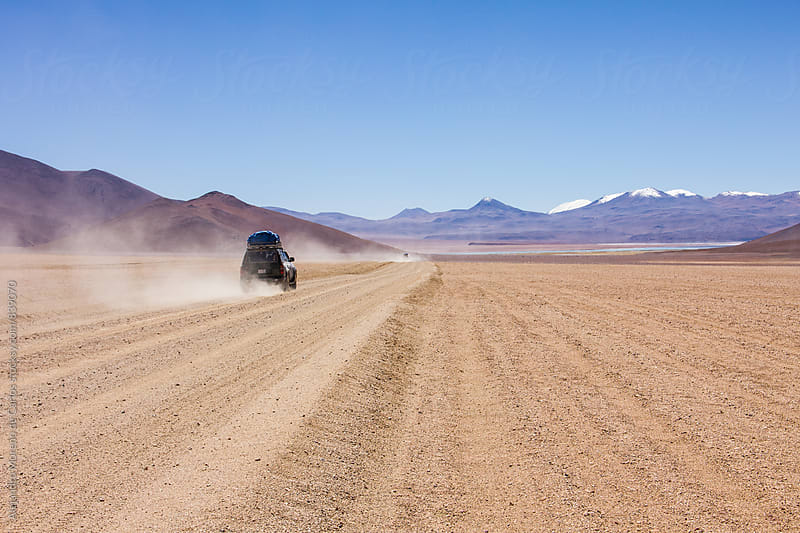 4wd car driving off road on the desert. Eduardo Abaroa National park, Bolivia by Alejandro Moreno de Carlos for Stocksy United