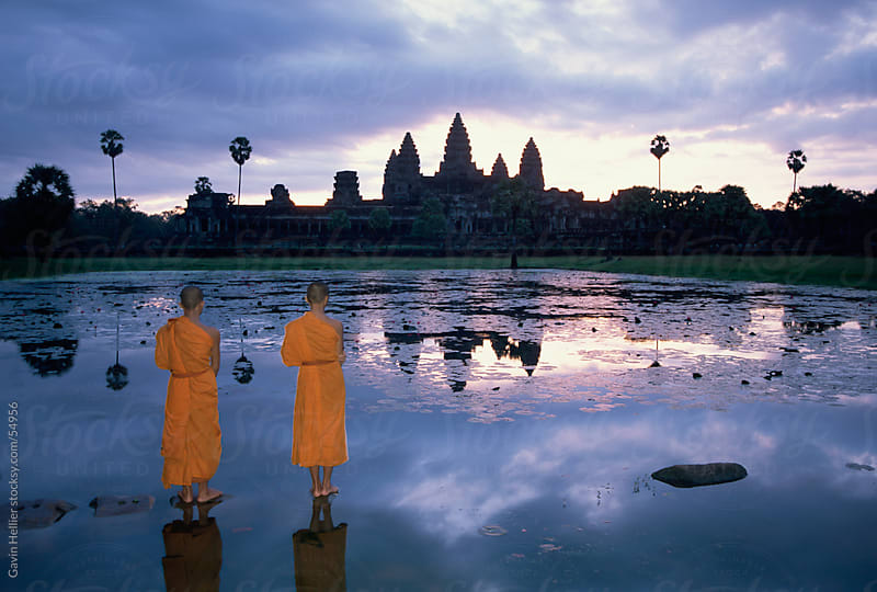 Buddhist monks standing in front of Angkor Wat, Angkor, UNESCO World Heritage Site, Siem Reap, Cambo by Gavin Hellier for Stocksy United