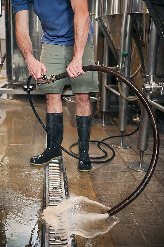 Beer: Cleaning Out Yeast Transfer Hose by Sean Locke for Stocksy United