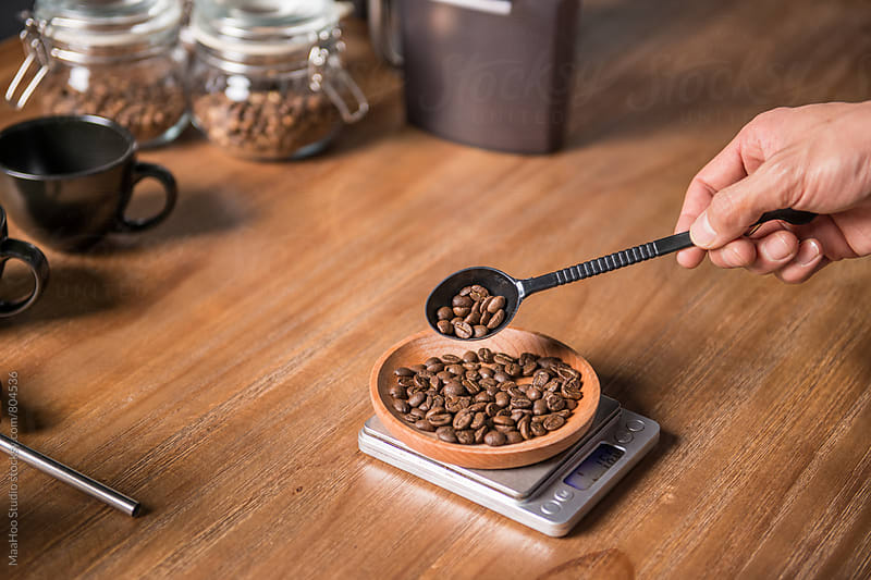 Man weighting coffee bean to prepare coffee by MaaHoo Studio for Stocksy United