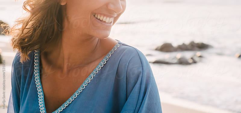 Smiling Woman by the Ocean.  by Marija Savic for Stocksy United