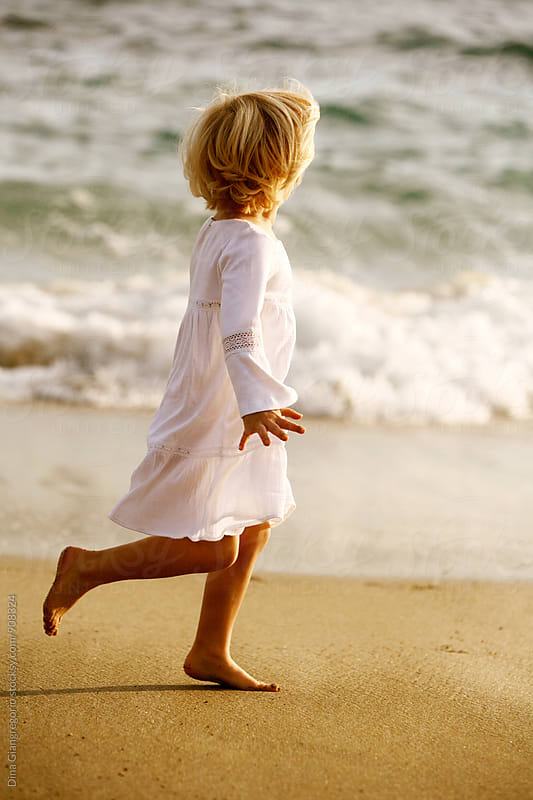 Little Girl in White Dress Running On Beach by Dina Giangregorio for Stocksy United
