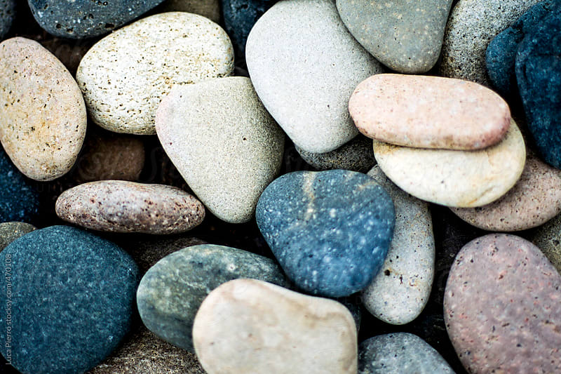 Rounded pebbles at the beach by Luca Pierro for Stocksy United